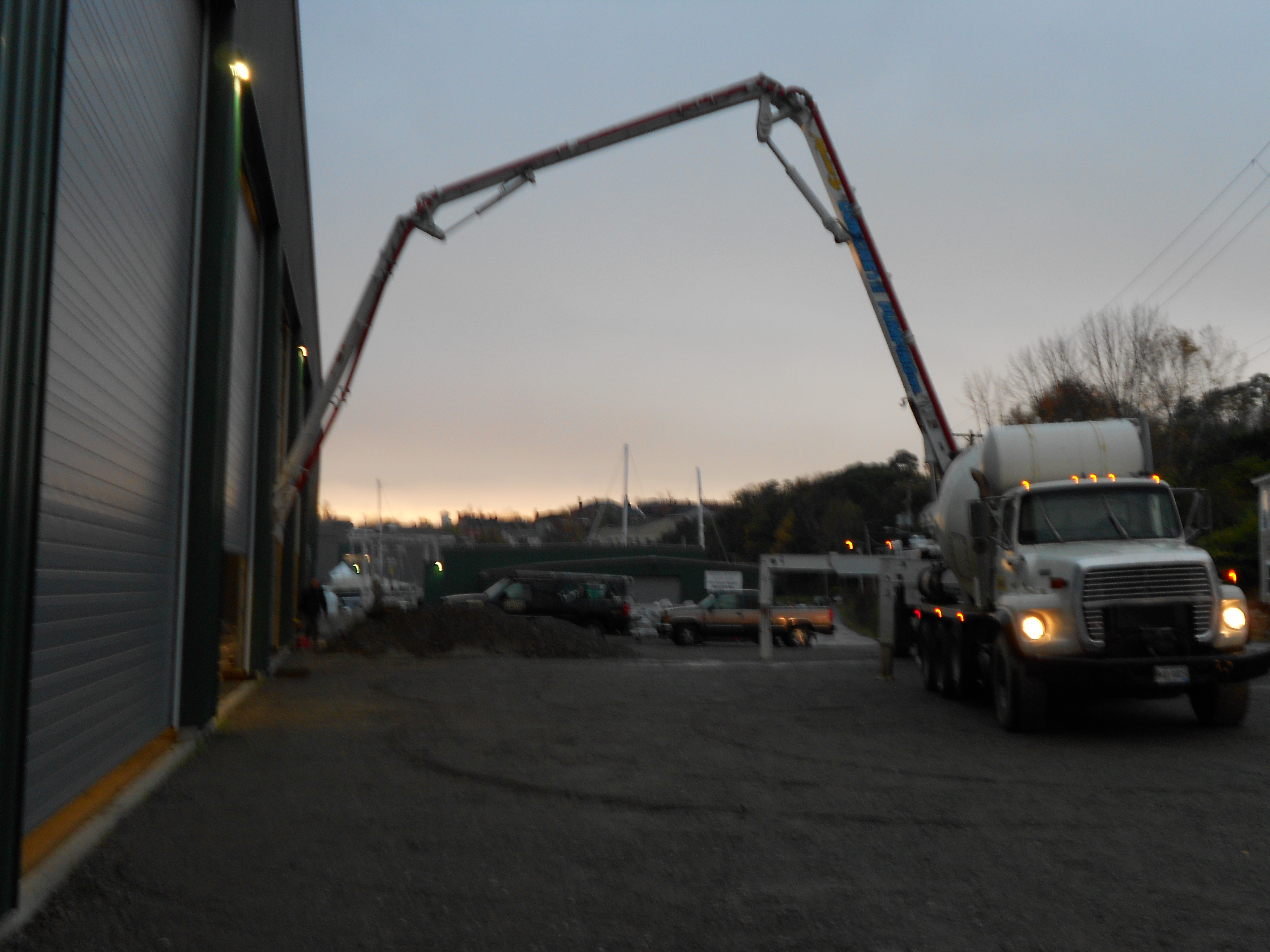 Pumping concrete to cover the radiant heated floor
