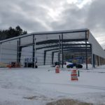 Demillo's Boatyard photos. This 80x150x 23' high building was erected right through the winter. Our crew braved the weather and still beat the budget.